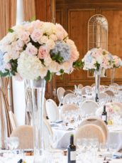 Dusty blue and pink wedding flowers reception tall centrepieces Cherie Kelly cakes London Hedsor House 3