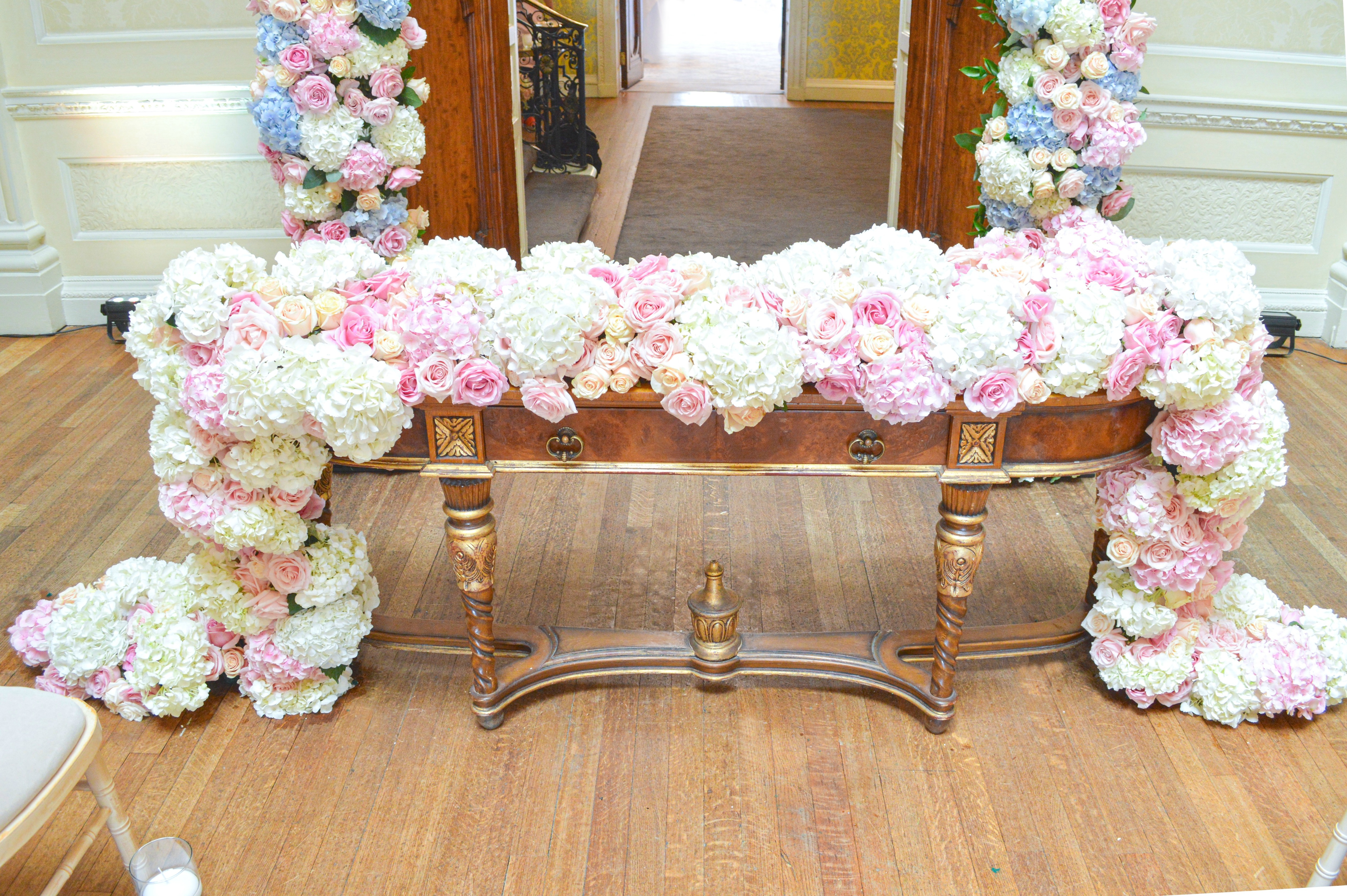 Dusty blue and pink wedding flowers registrar table head toptable floral garland wedding ceremony Cherie Kelly cakes London Hedsor House