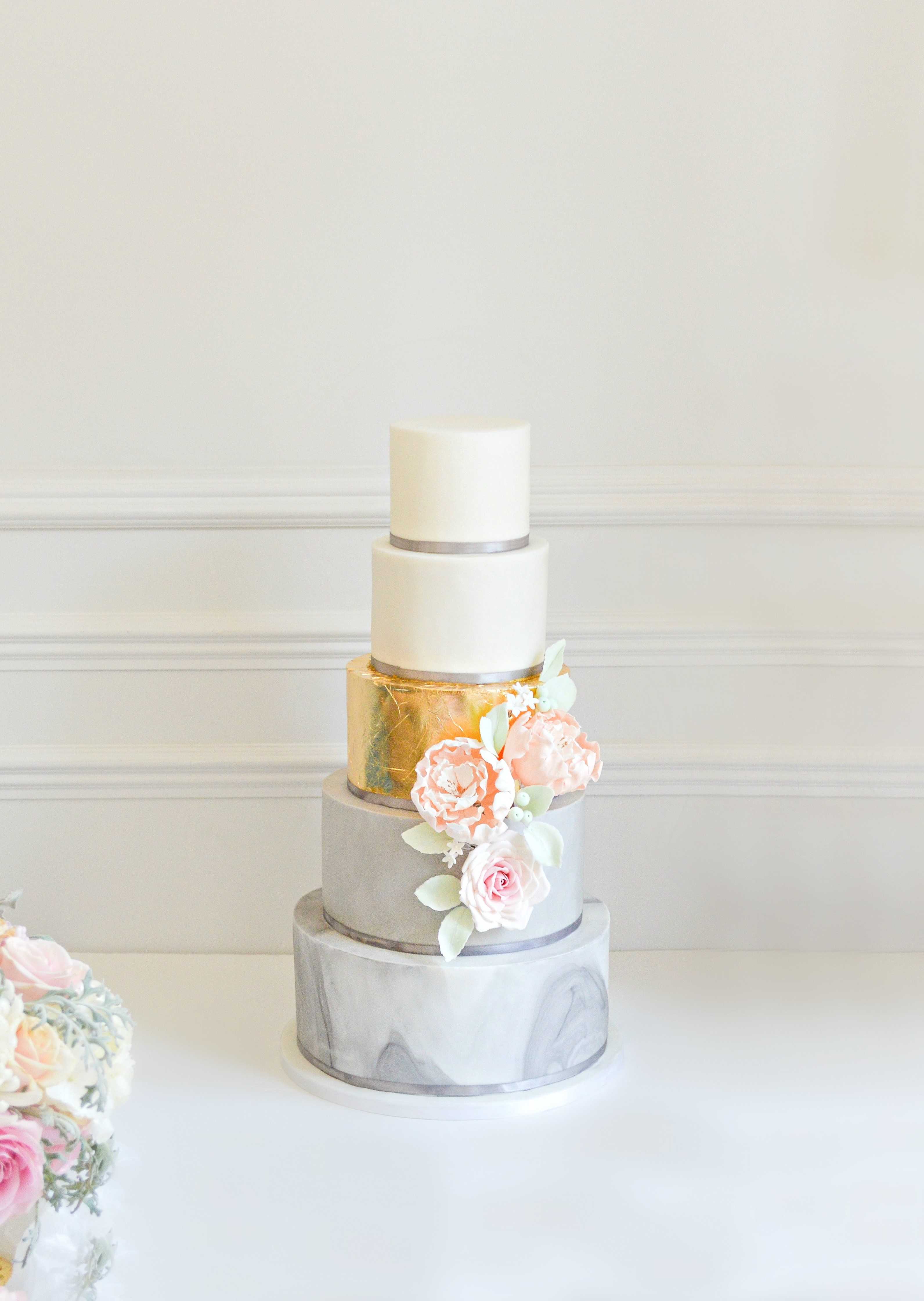Marble pattern wedding cake with gold leaf tier Cherie Kelly cakes London Hedsor House