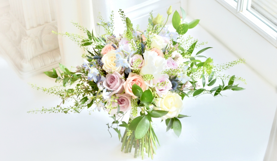 Rustic pink and blue Roses, Thistle, Lisianthus, Peonies, David Austin roses, Delphinium and foliage bridal bouquet Cherie Kelly wedding flowers London