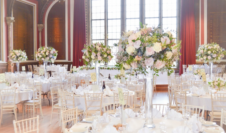 Natural garden rustic style spring pastel pink blue lilac high and low table centrepieces floral arrangement wedding reception Cheire Kelly cakes and flowers London