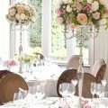 Cherie-Kelly-Fawsley-Hall-Wedding-reception-top-and-guests-table-candelabra-flower-arrangements-tall-and-low-centrepieces-with-candles