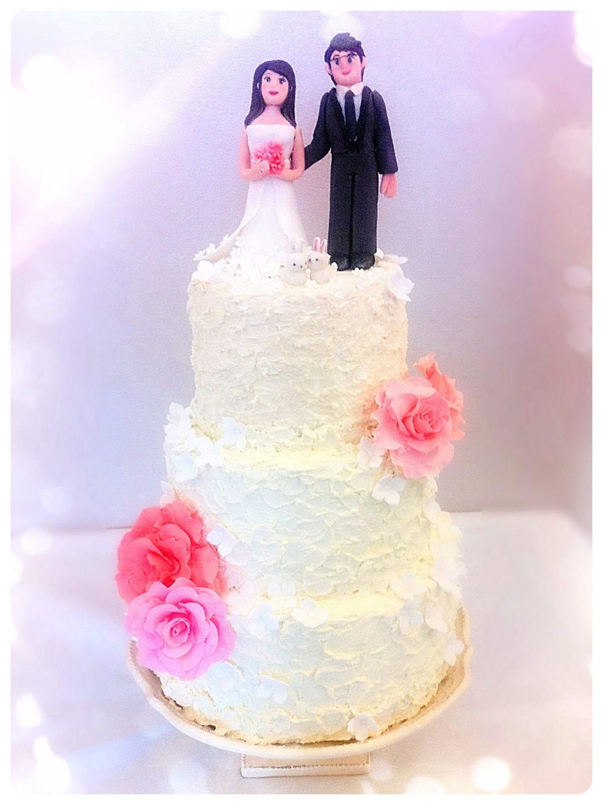 Sweet Swirly Buttercream Frosting Wedding Cake with Bride and Groom Cake Toppers Cherie Kelly London