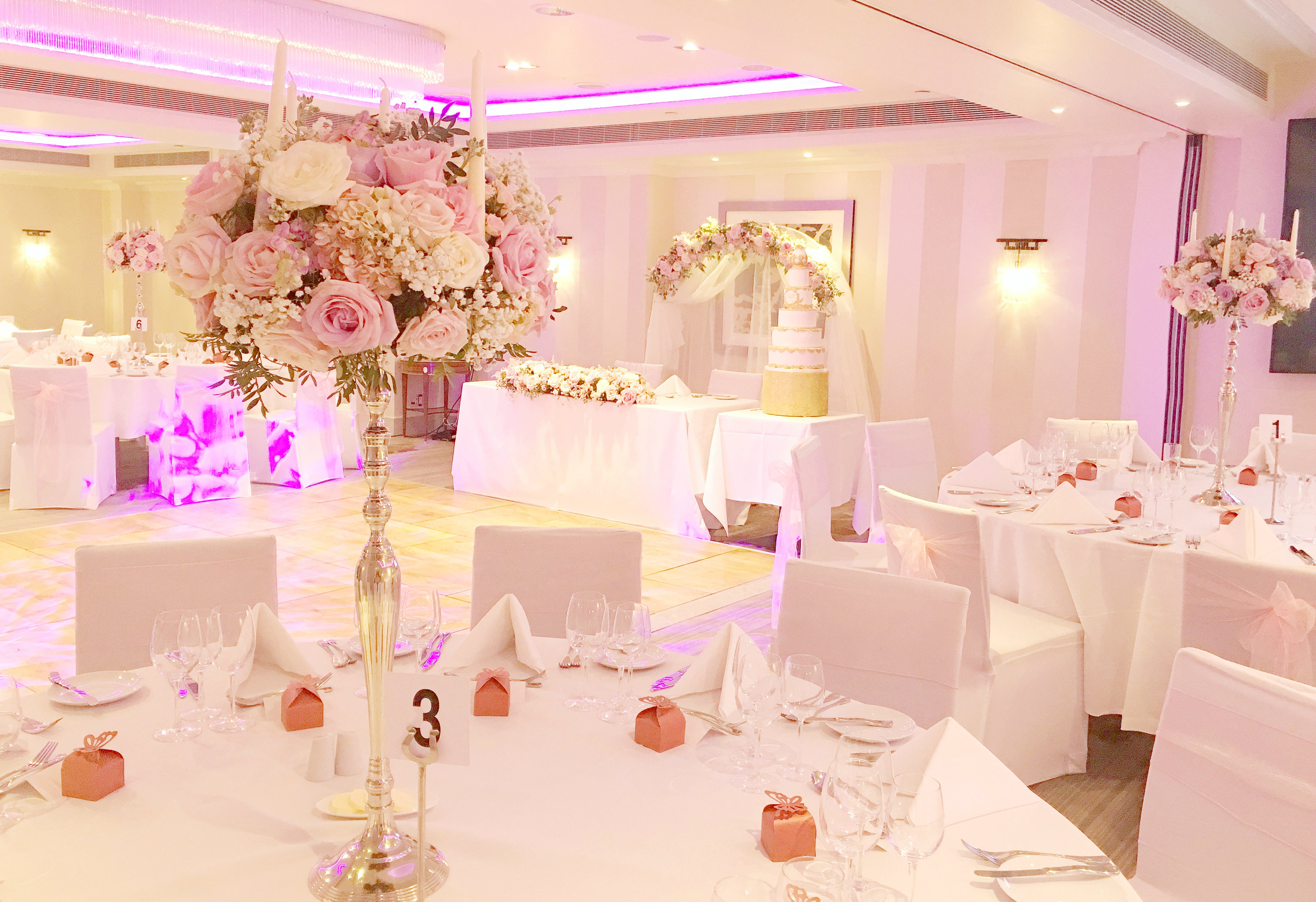 Pink and lilac tall candelabra wedding centrepieces with roses flowers Cherie Kelly London Sofitel St James