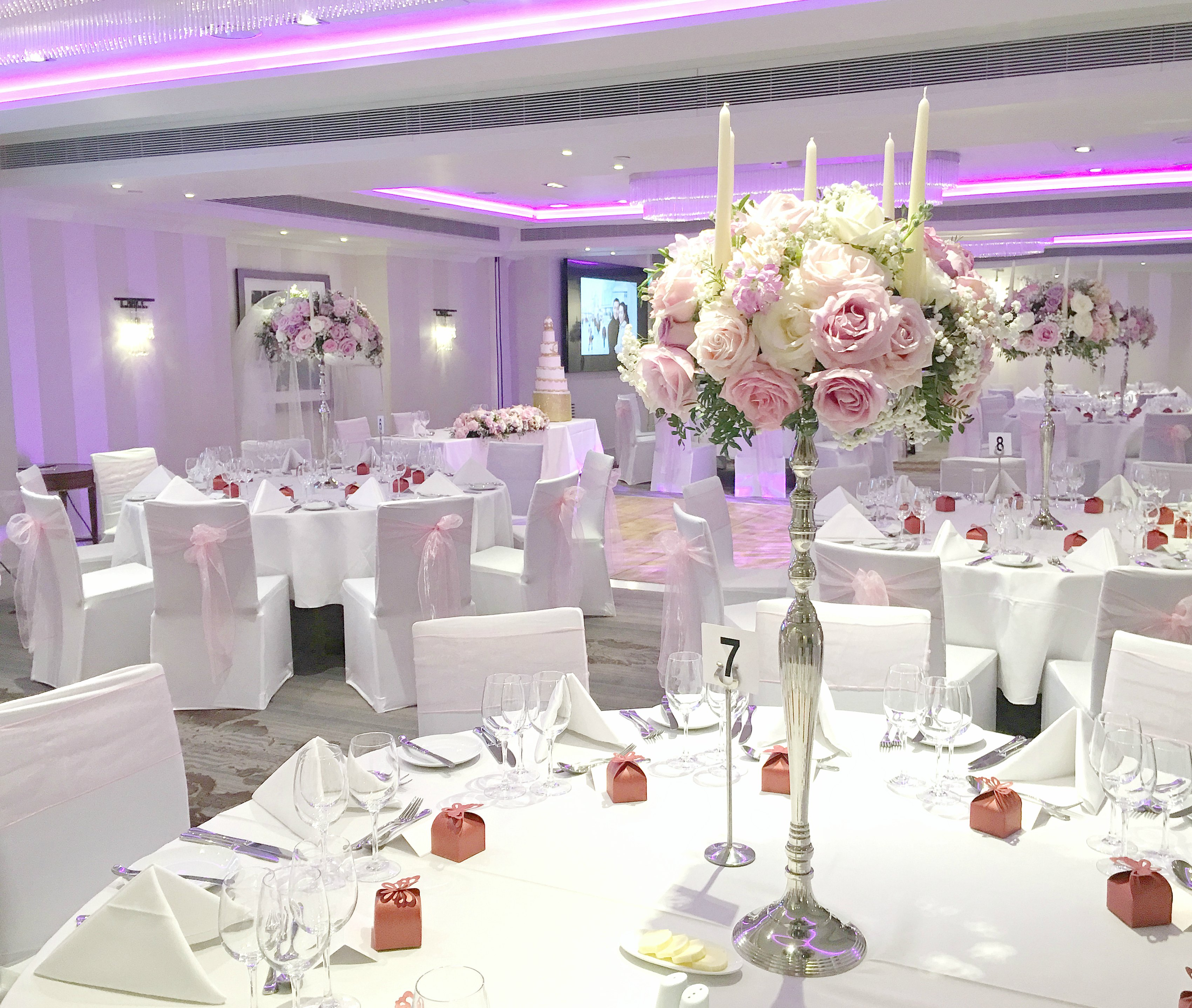 Pink and lilac wedding head table with flower arch backdrop with roses flowers Cherie Kelly London Sofitel St James