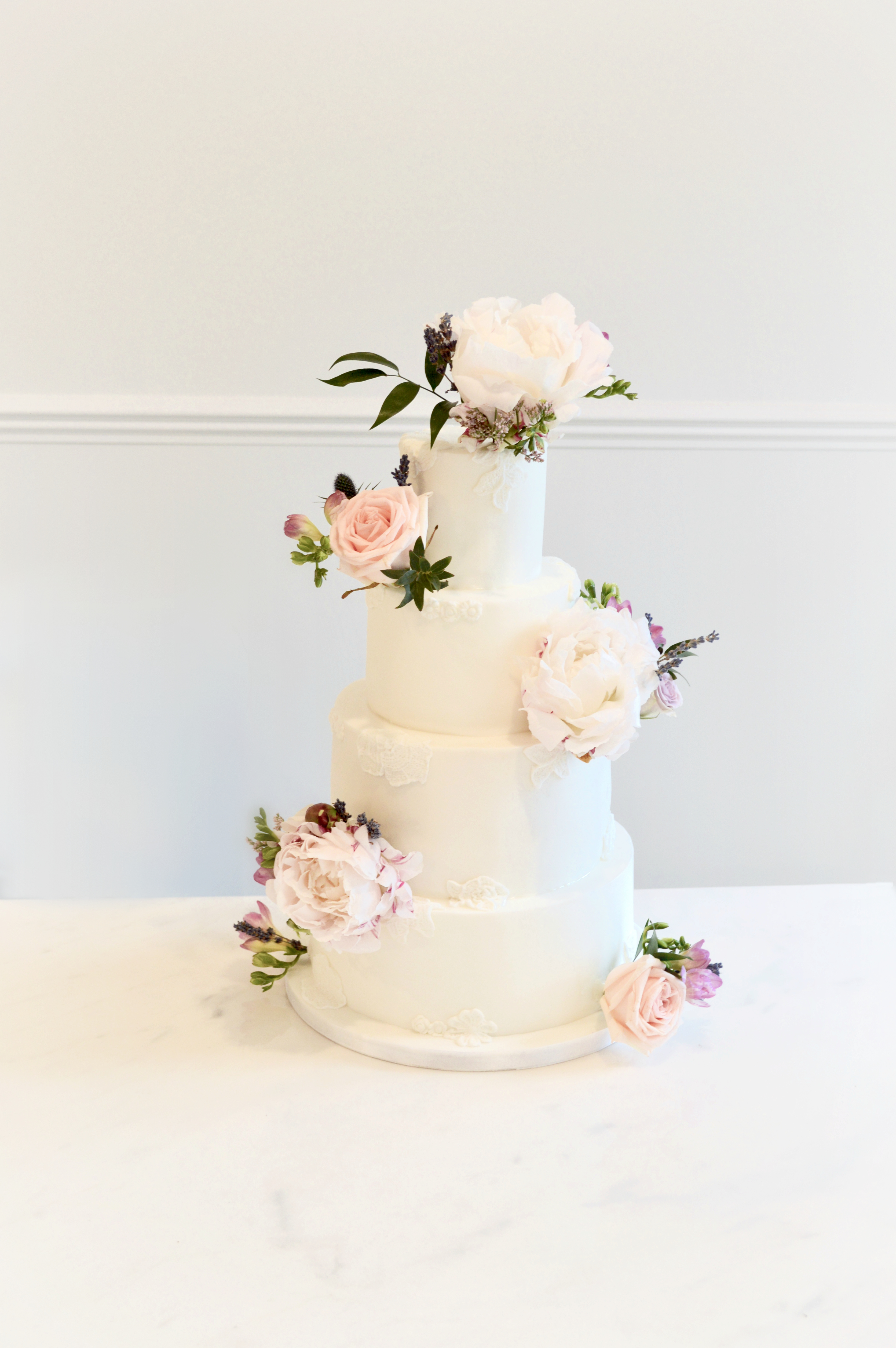 Rustic pink and blue Roses, Thistle, Lisianthus, Peonies, David Austin roses, Delphinium and foliage lace wedding cake Cherie Kelly flowers London
