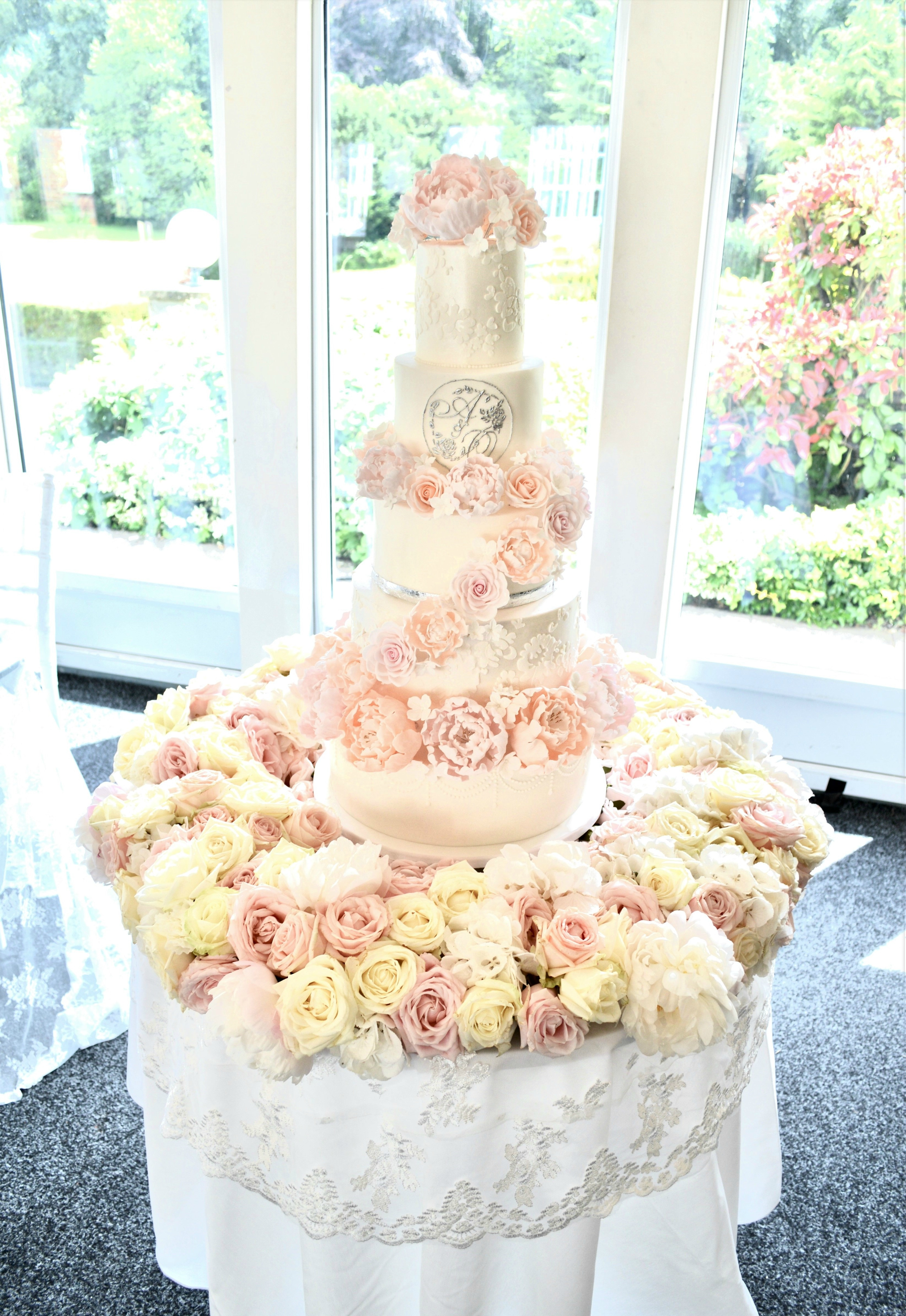 Luxury Blush Pink and White Hunton Park 6 Tier Peony, Roses and Hydrangeas Cascade Open Stack with Monogram Lace Cherie Kelly Wedding Cake London