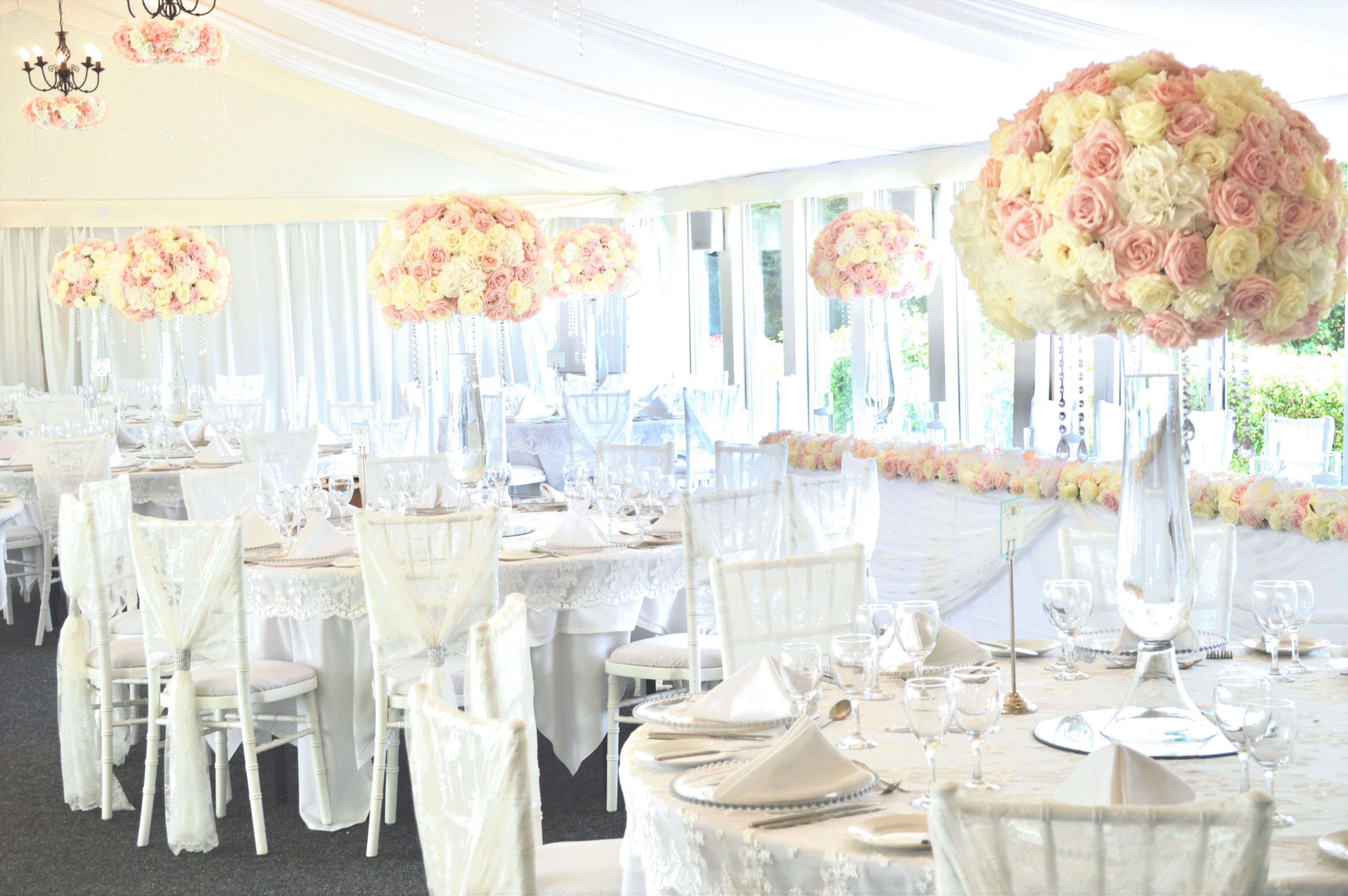 Luxury Blush Pink and White Wedding Flowers and Cake at Hunton Park Peony Hydrangeas and Roses Tall Vase Centrepieces with Crystals and Floral Chandelier Cherie Kelly Cake London