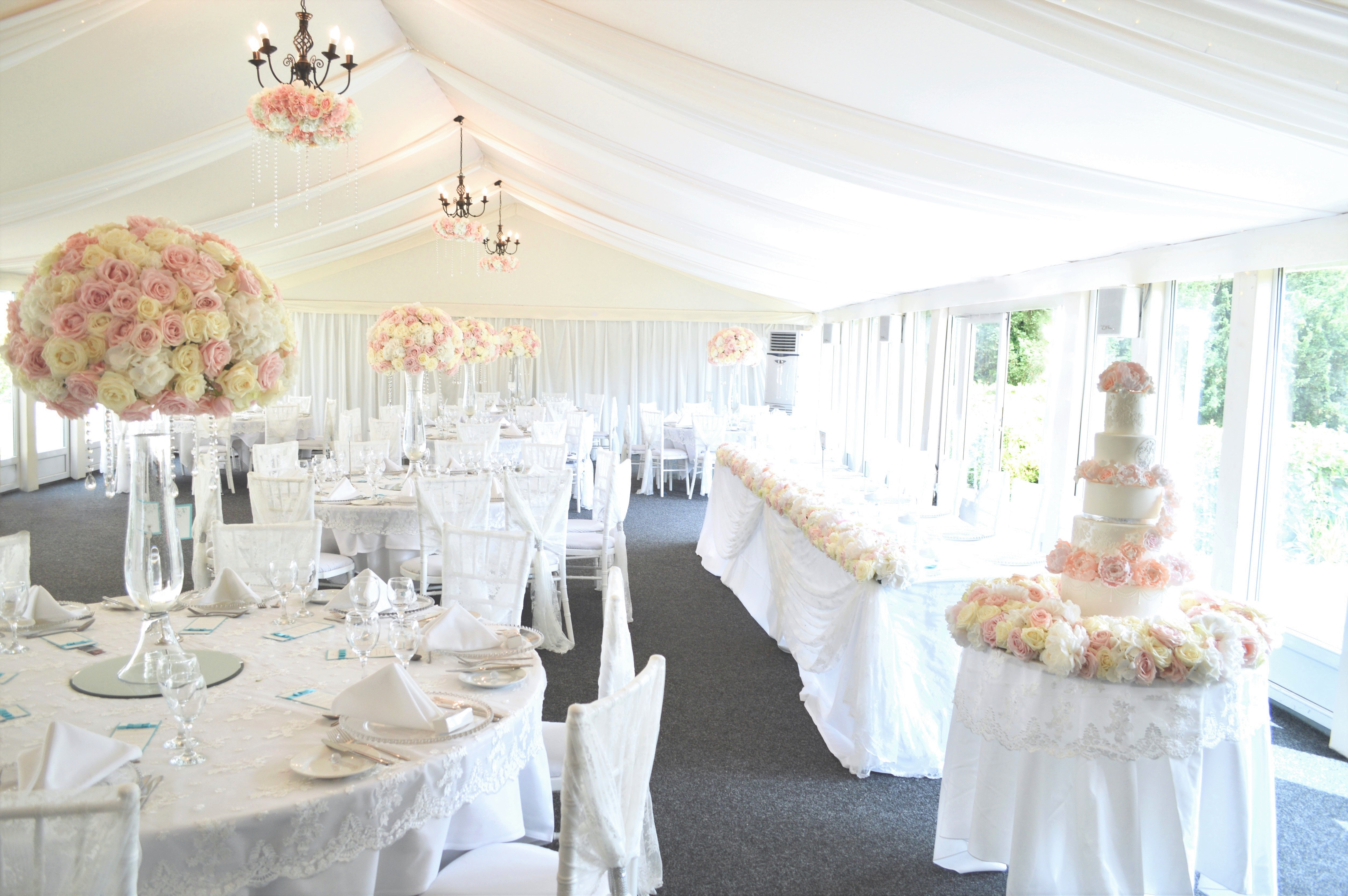 Luxury Blush Pink and White Wedding Flowers and Cake at Hunton Park Peony Hydrangeas and Roses Tall Vase Centrepieces with Crystals and Floral Chandelier Headtop Cherie Kelly Wedding Cake London