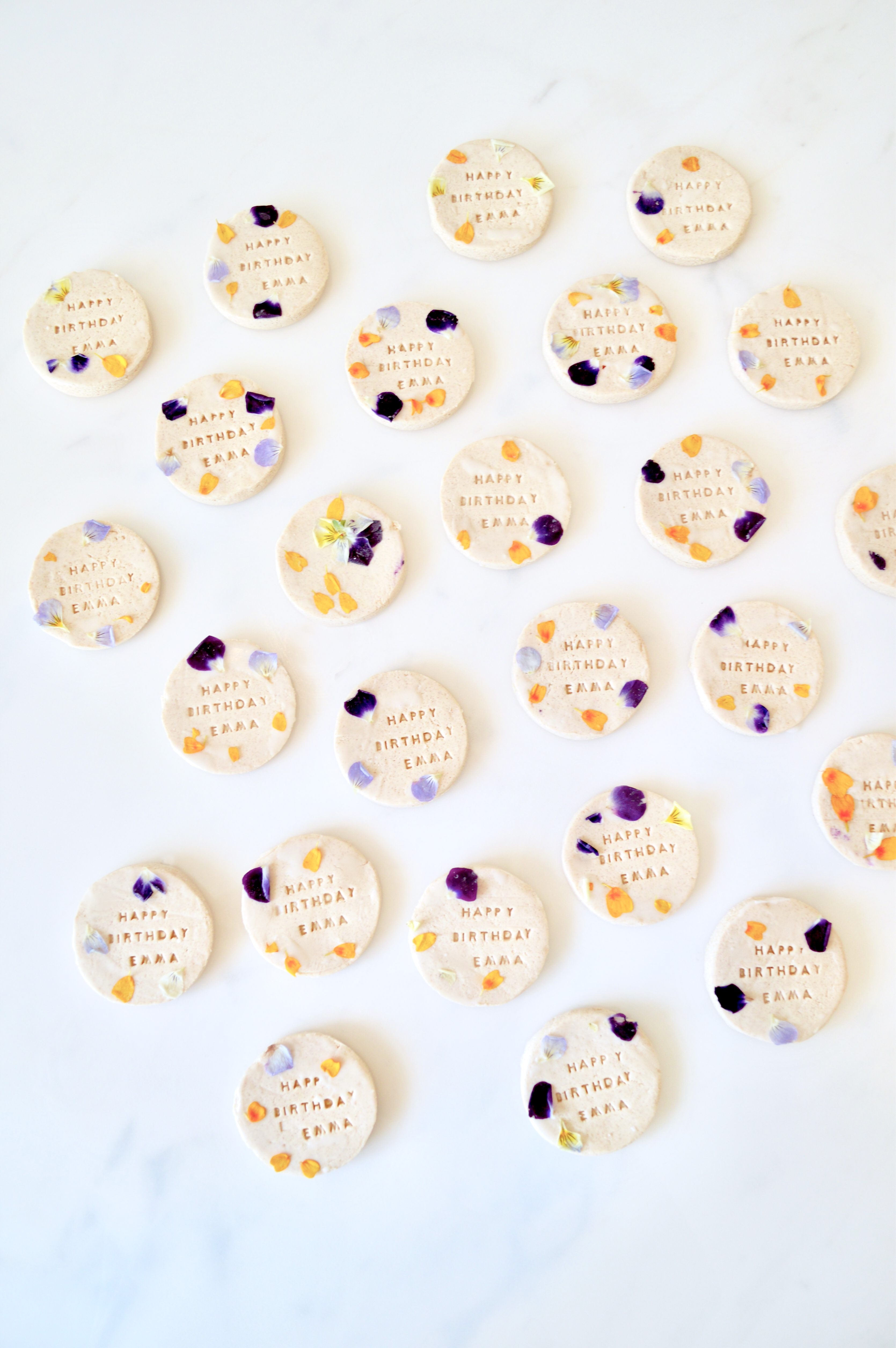 Edible flower pressed shortbread cookies with personalised name wedding favours Cherie Kelly cakes London