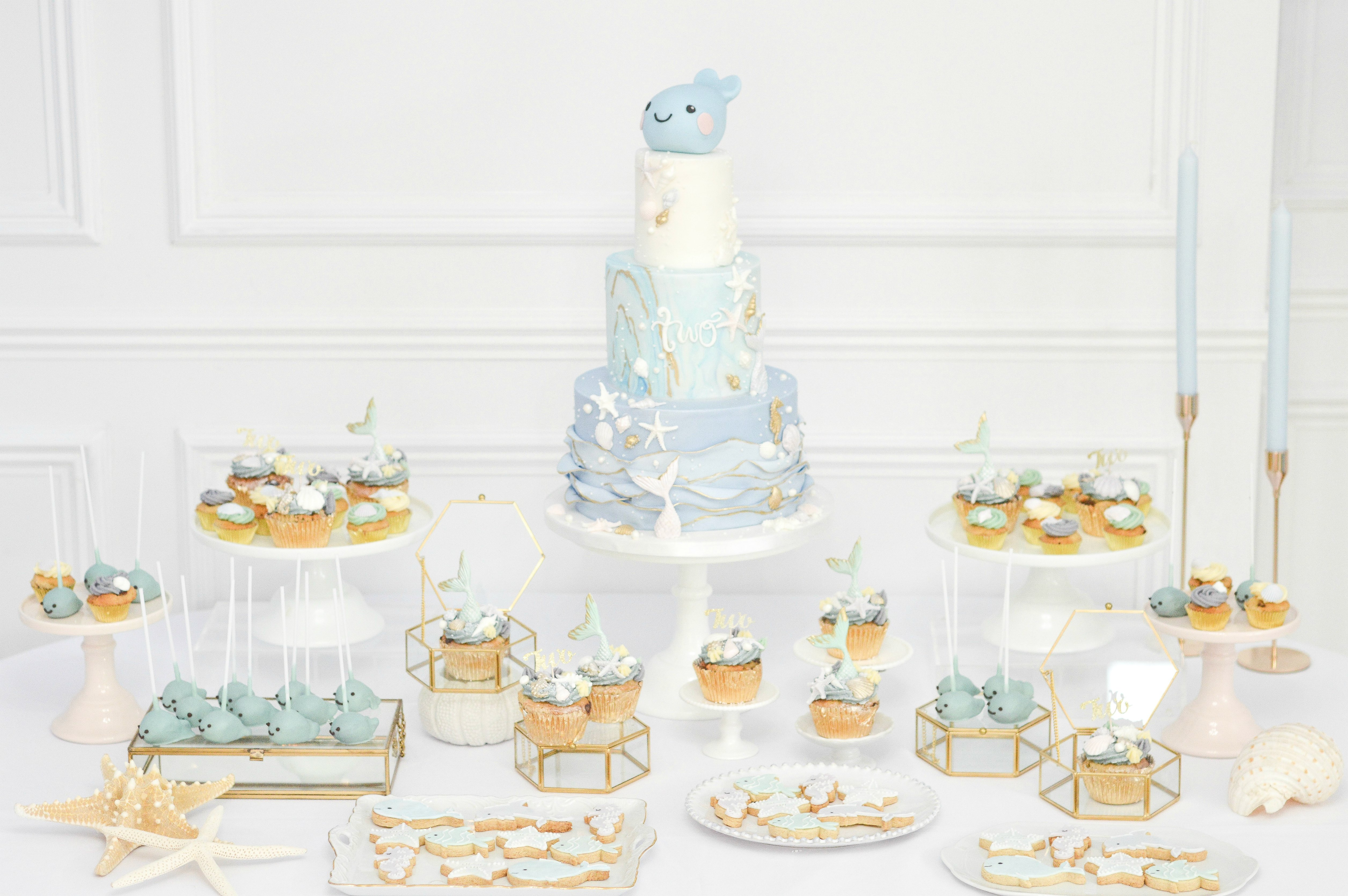 Under the sea themed birthday party cake dessert table cookies mermaid cakepops cupcakes Cherie Kelly cakes