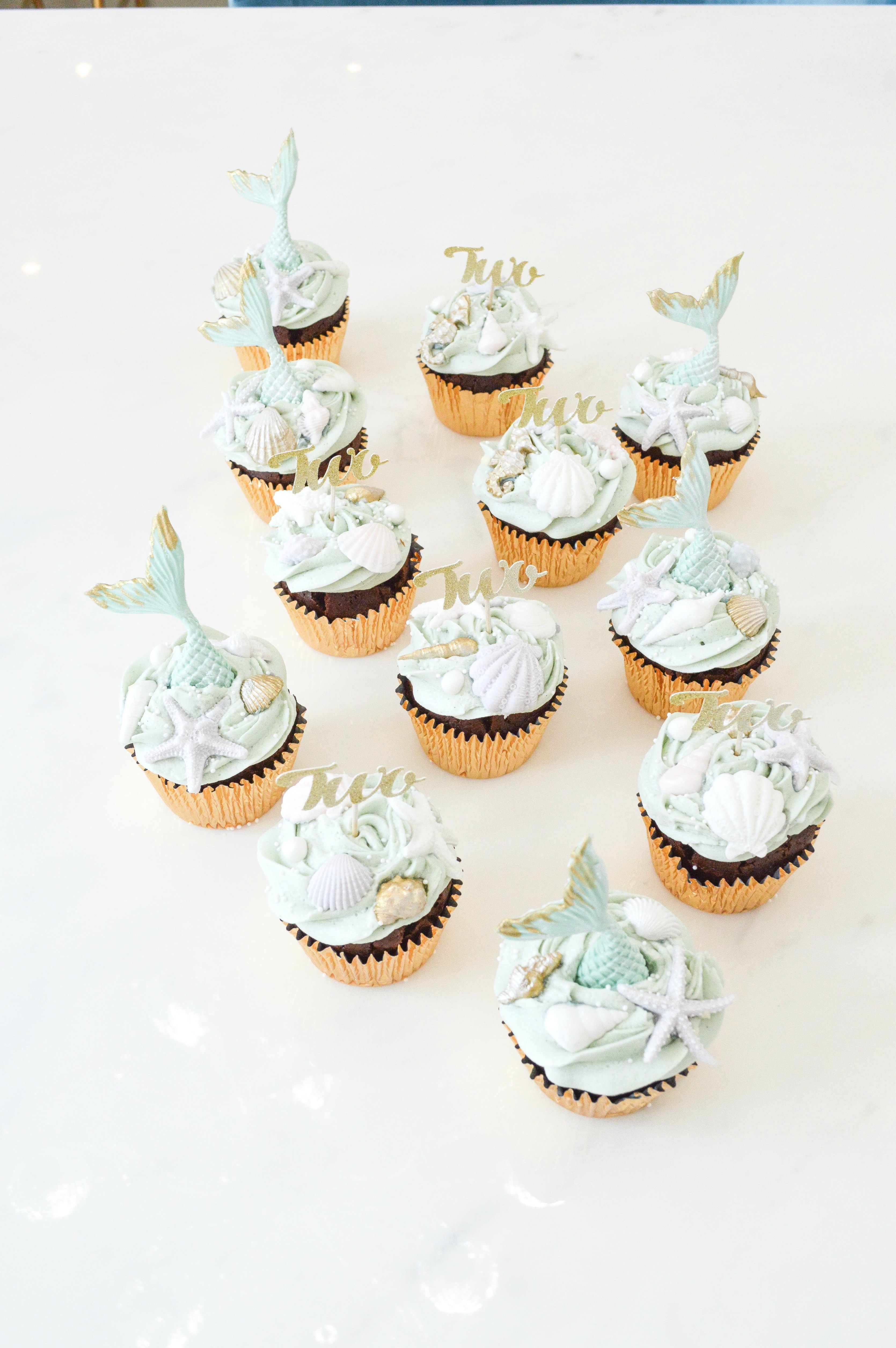 Under the sea themed birthday party cake dessert table mermaid cupcakes Cherie Kelly cakes London