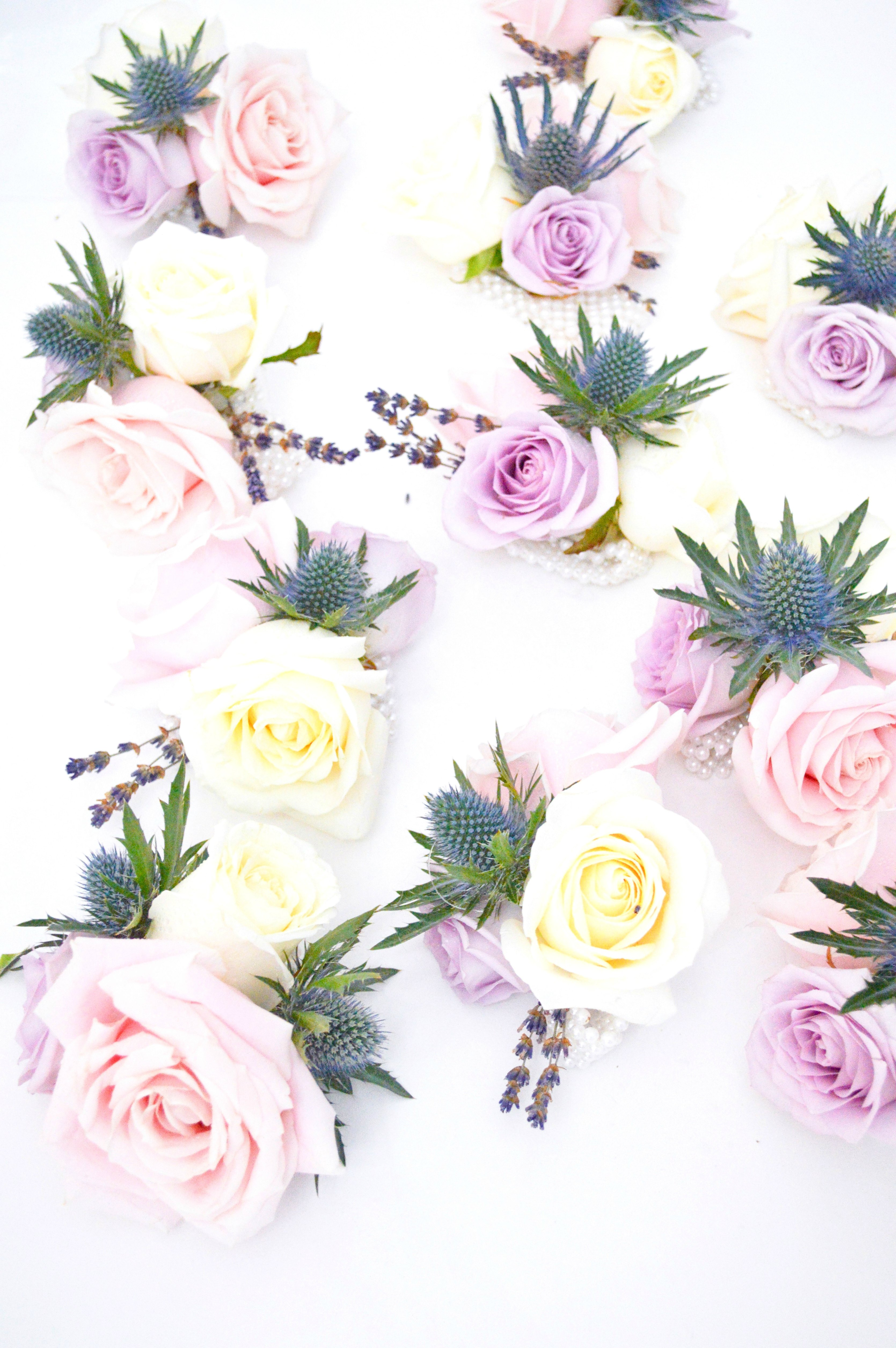 Natural garden rustic style spring pastel pink blue lilac corsages Cherie Kelly wedding flowers London