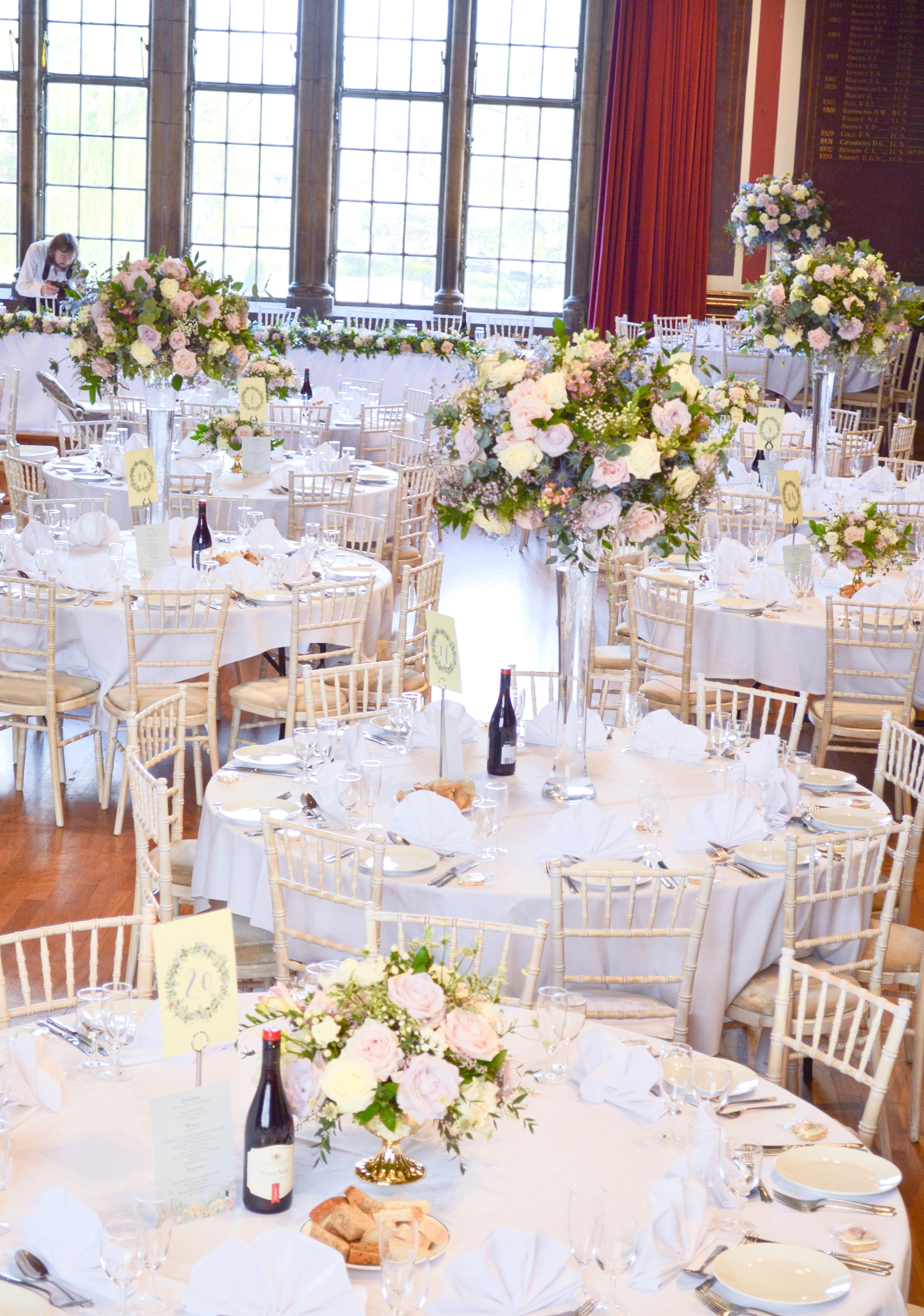 Natural garden rustic style spring pastel pink blue lilac high and low table centrepieces floral arrangement wedding reception Dulwich College Cherie Kelly wedding flowers London 2