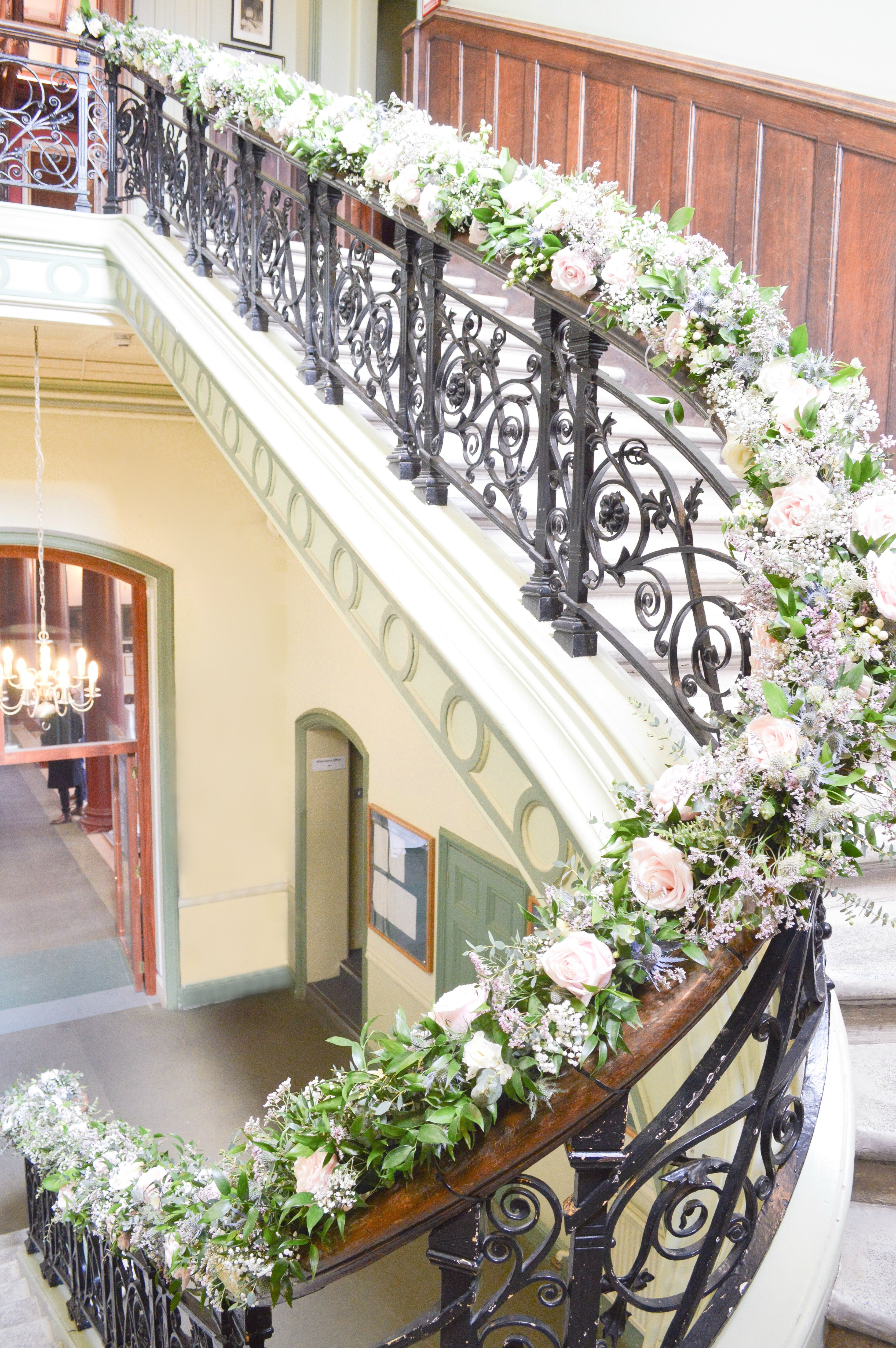 Natural garden rustic style spring pastel pink blue lilac staircase flowers Dulwich College Wedding Cherie Kelly flowers London