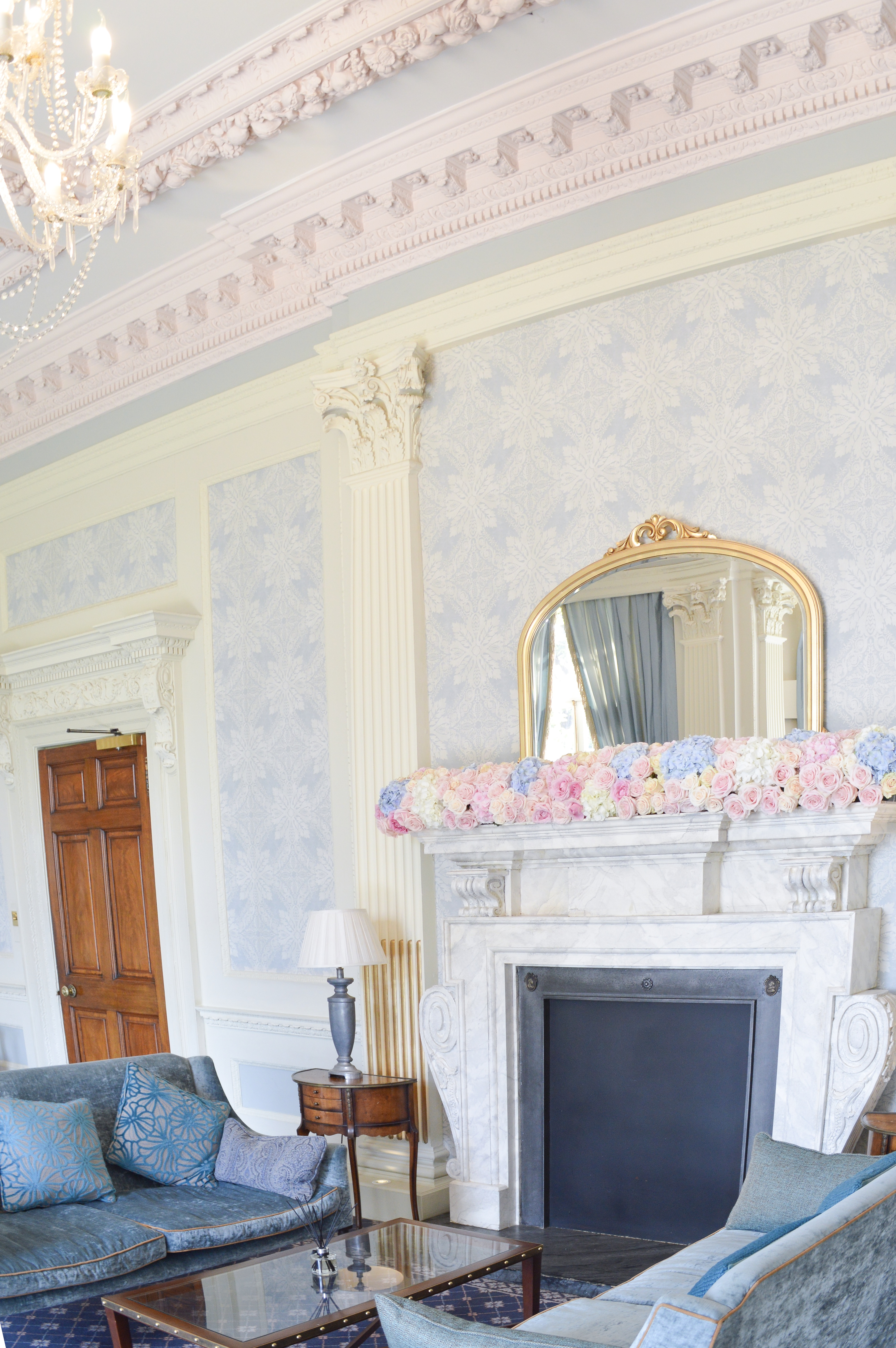 Dusty blue and pink wedding fireplace arrangements wedding ceremony aisle tall centrepieces Cherie Kelly cakes London Hedsor House 2