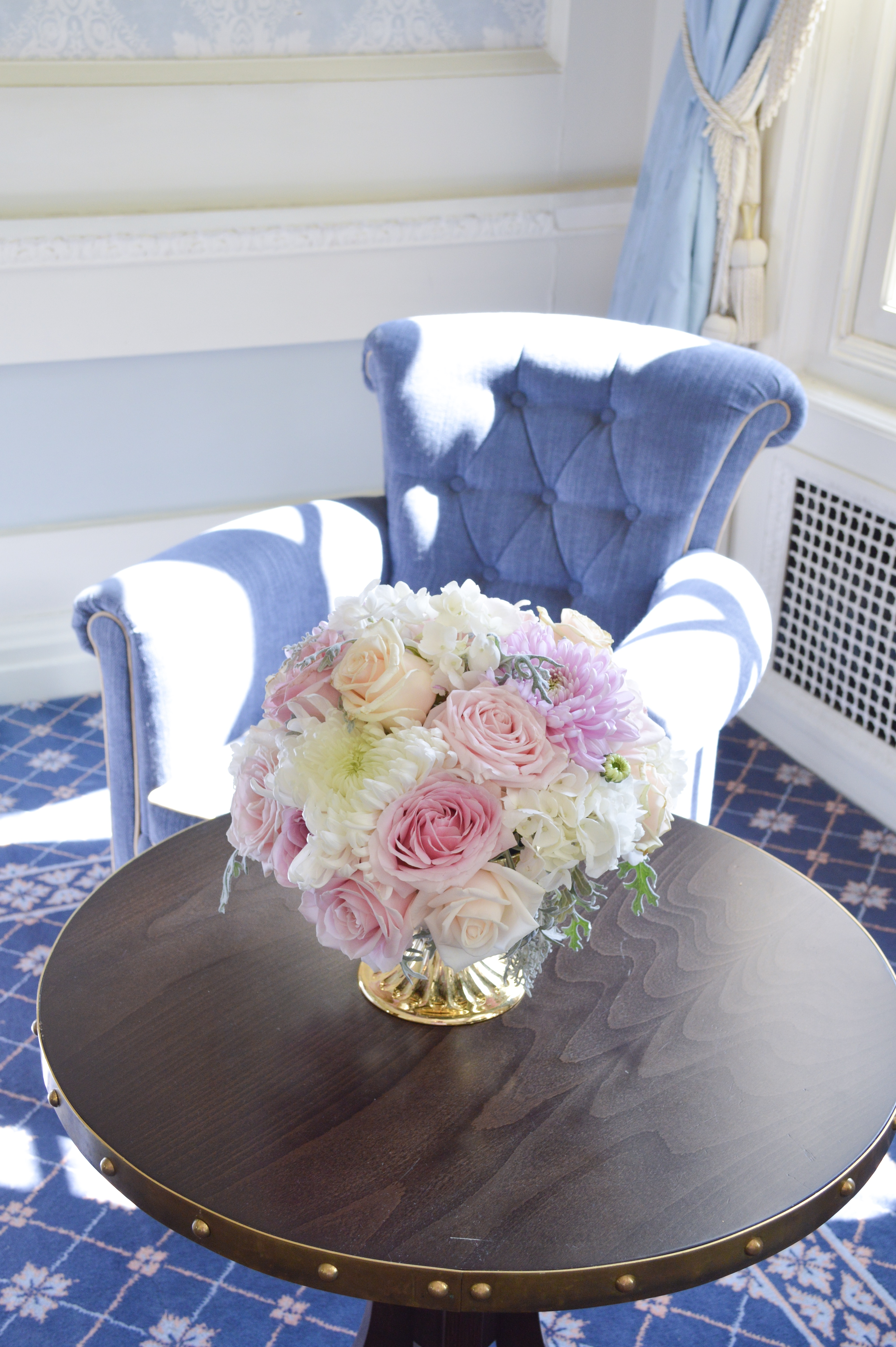 Dusty blue and pink wedding fireplace arrangements wedding low small centrepieces Cherie Kelly cakes London Hedsor House