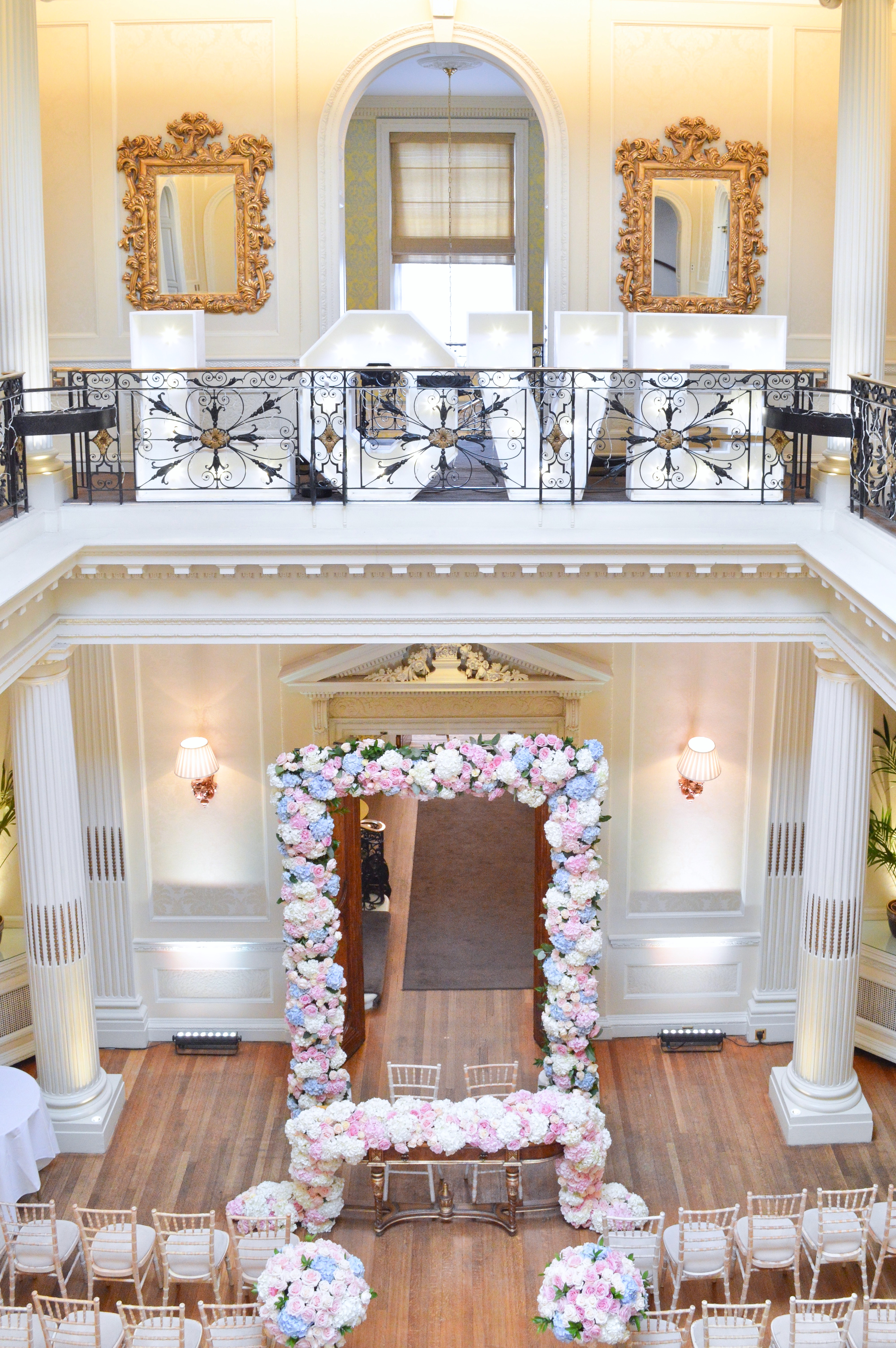 Dusty blue and pink wedding flowers arch registrar table head toptable floral garland wedding ceremony aisle floating candles Cherie Kelly cakes London Hedsor House (2)