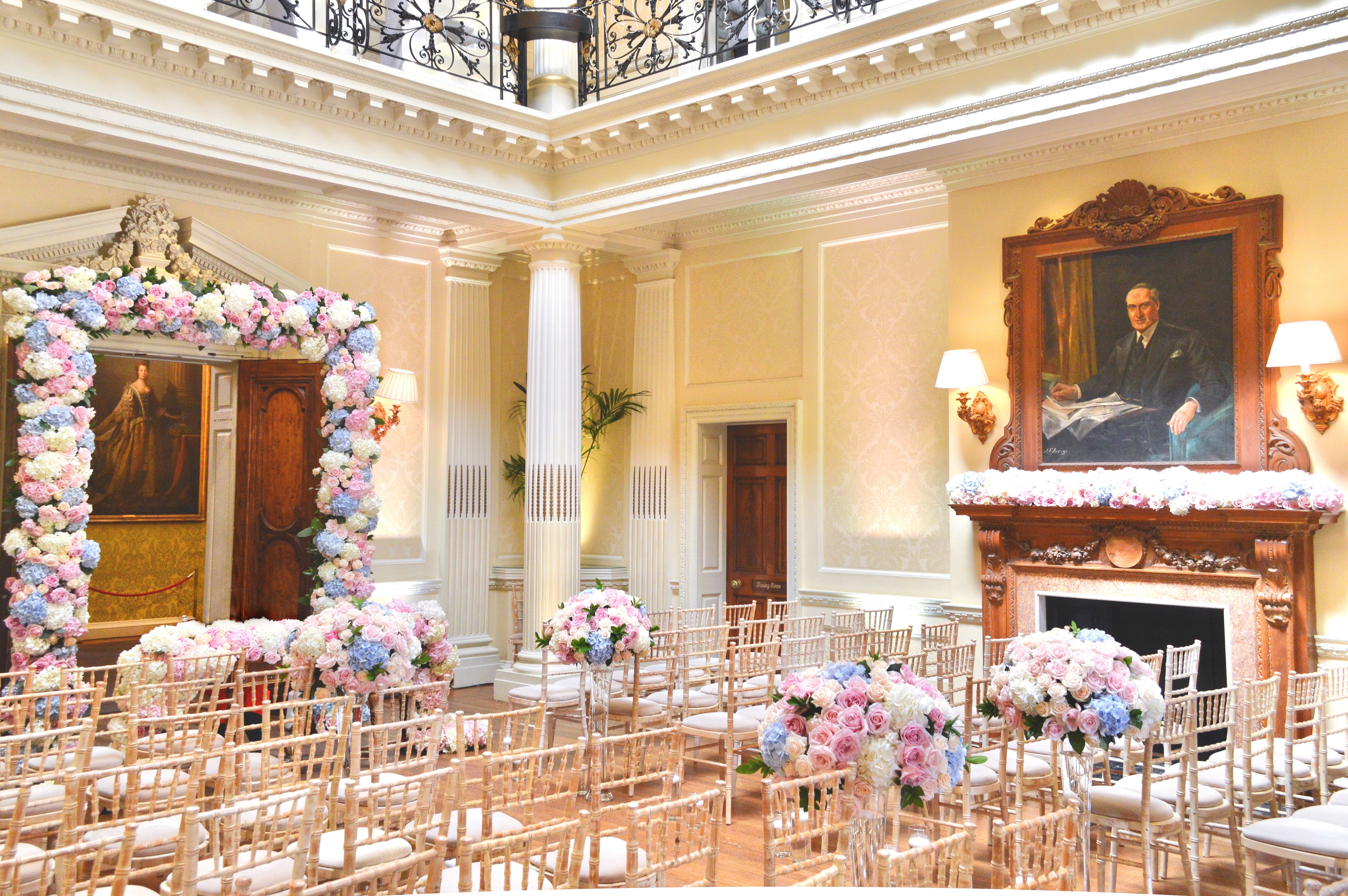 Dusty blue and pink wedding flowers arch registrar table head toptable floral garland wedding ceremony aisle floating candles Cherie Kelly cakes London Hedsor House 5