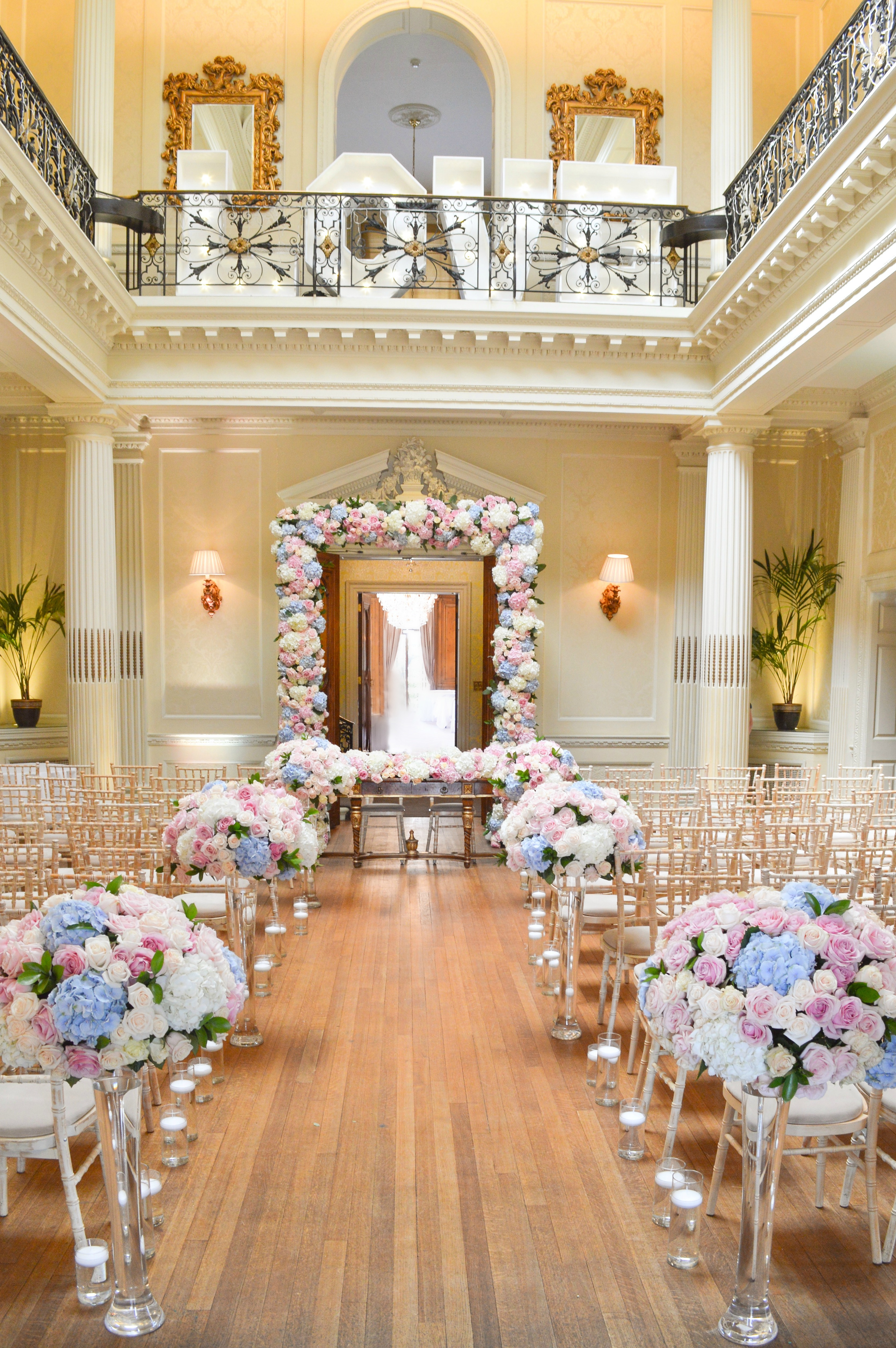 Dusty blue and pink wedding flowers arch registrar table head toptable floral garland wedding ceremony aisle floating candles Cherie Kelly cakes London Hedsor House