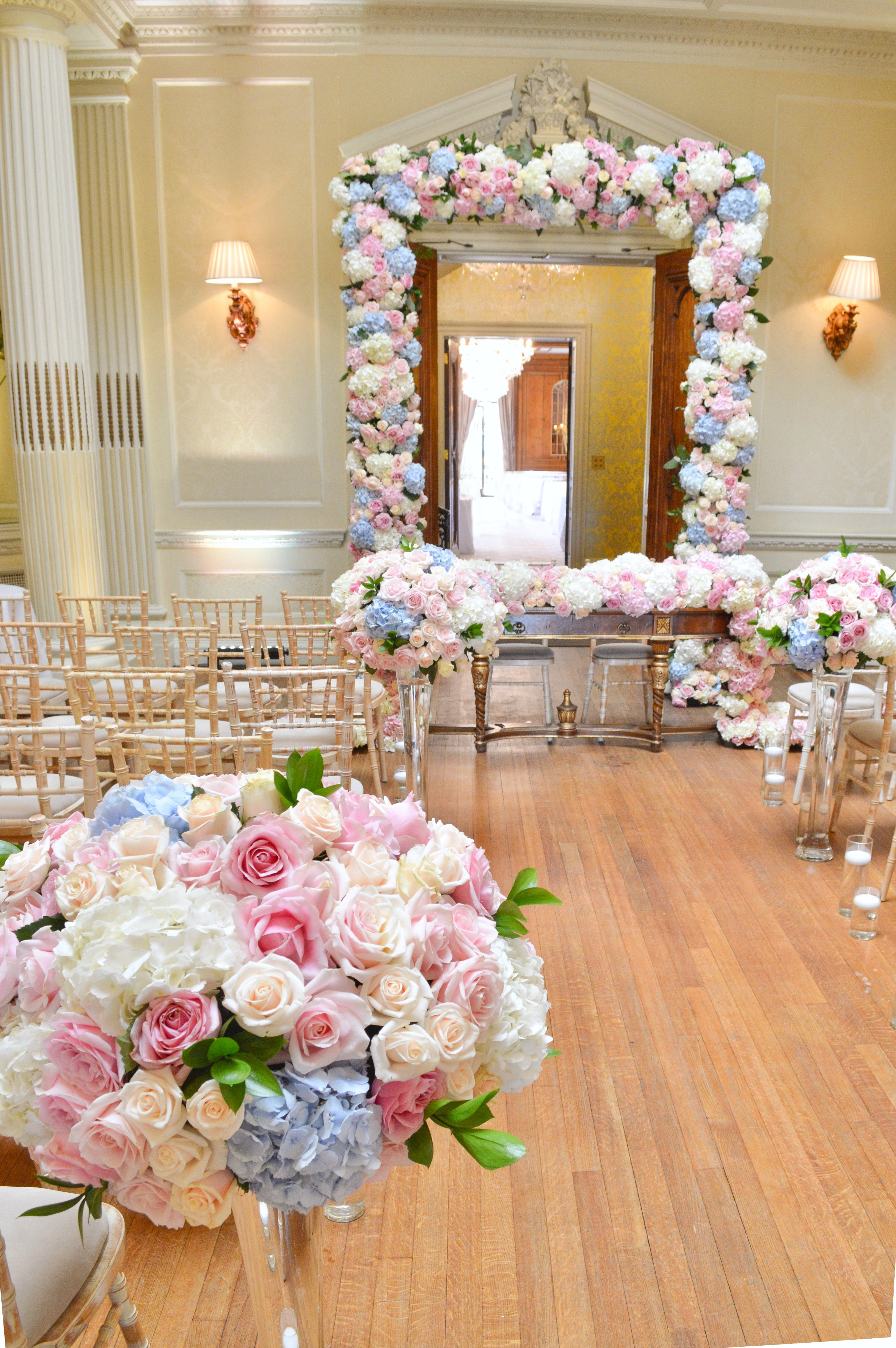 Dusty blue and pink wedding flowers arch registrar table head toptable floral garland wedding ceremony aisle tall centrepieces Cherie Kelly cakes London Hedsor House 4
