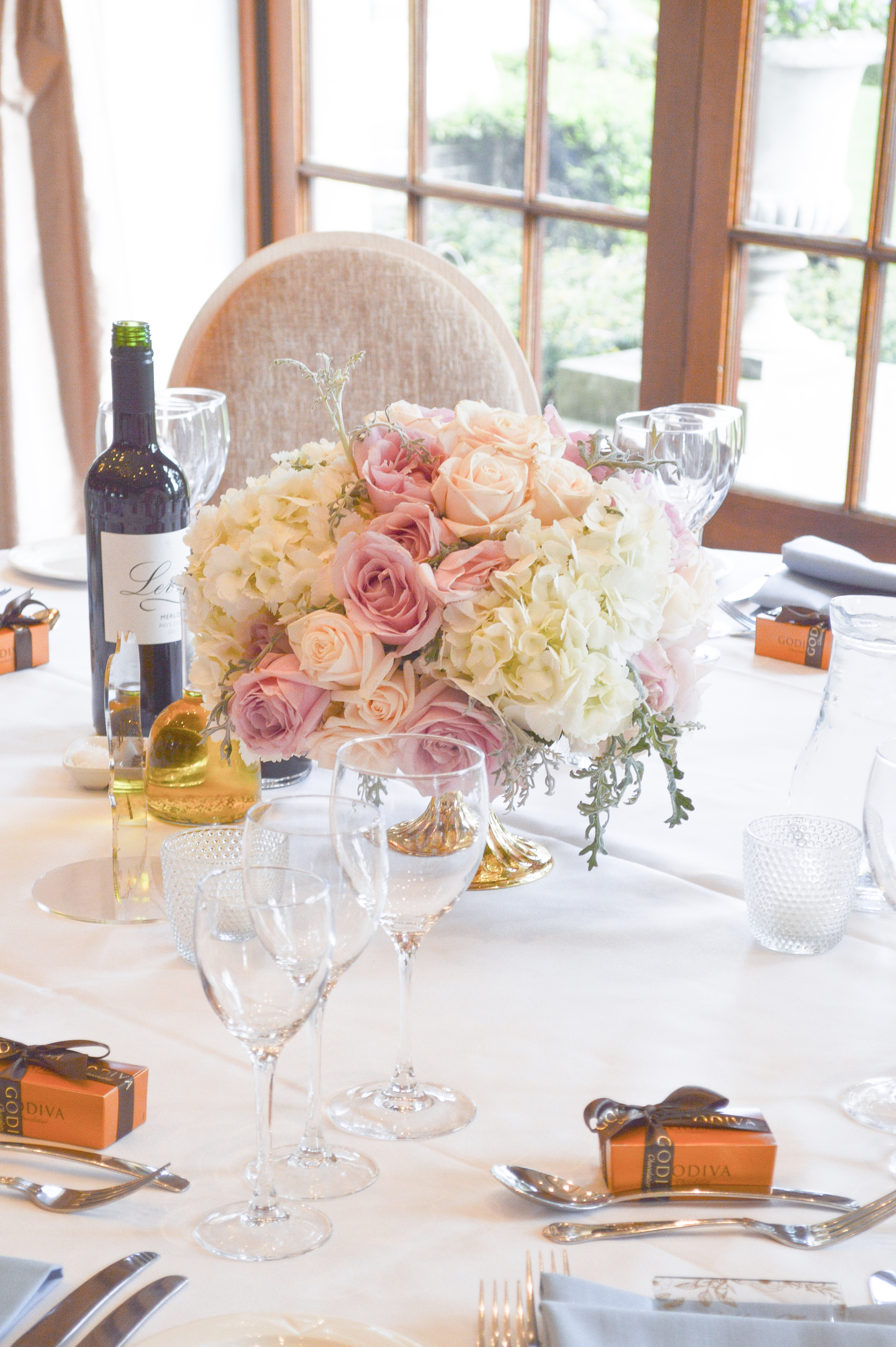 Dusty blue and pink wedding flowers reception tall and low centrepieces Cherie Kelly cakes London Hedsor House