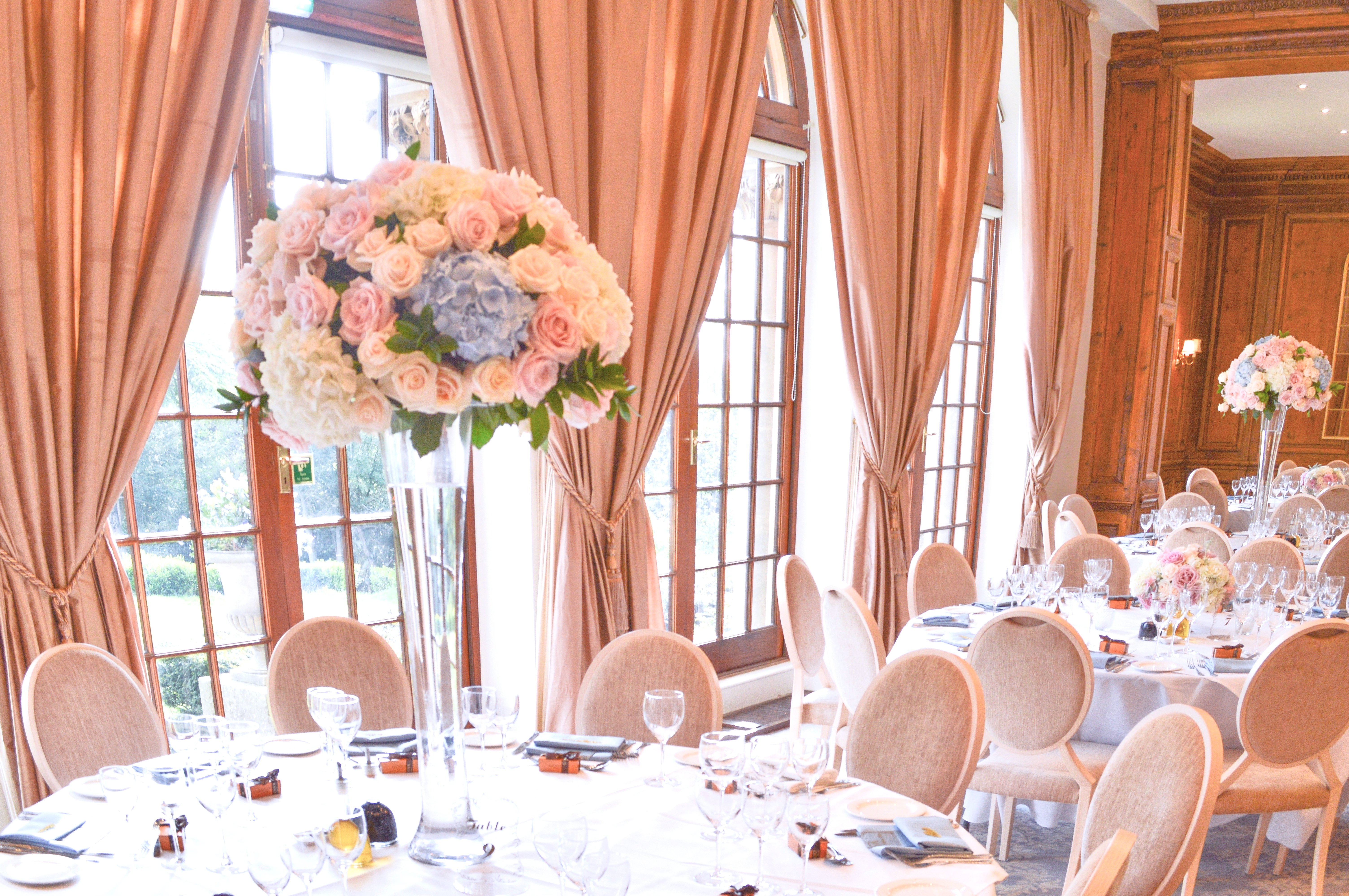 Dusty blue and pink wedding flowers reception tall centrepieces Cherie Kelly cakes London Hedsor House