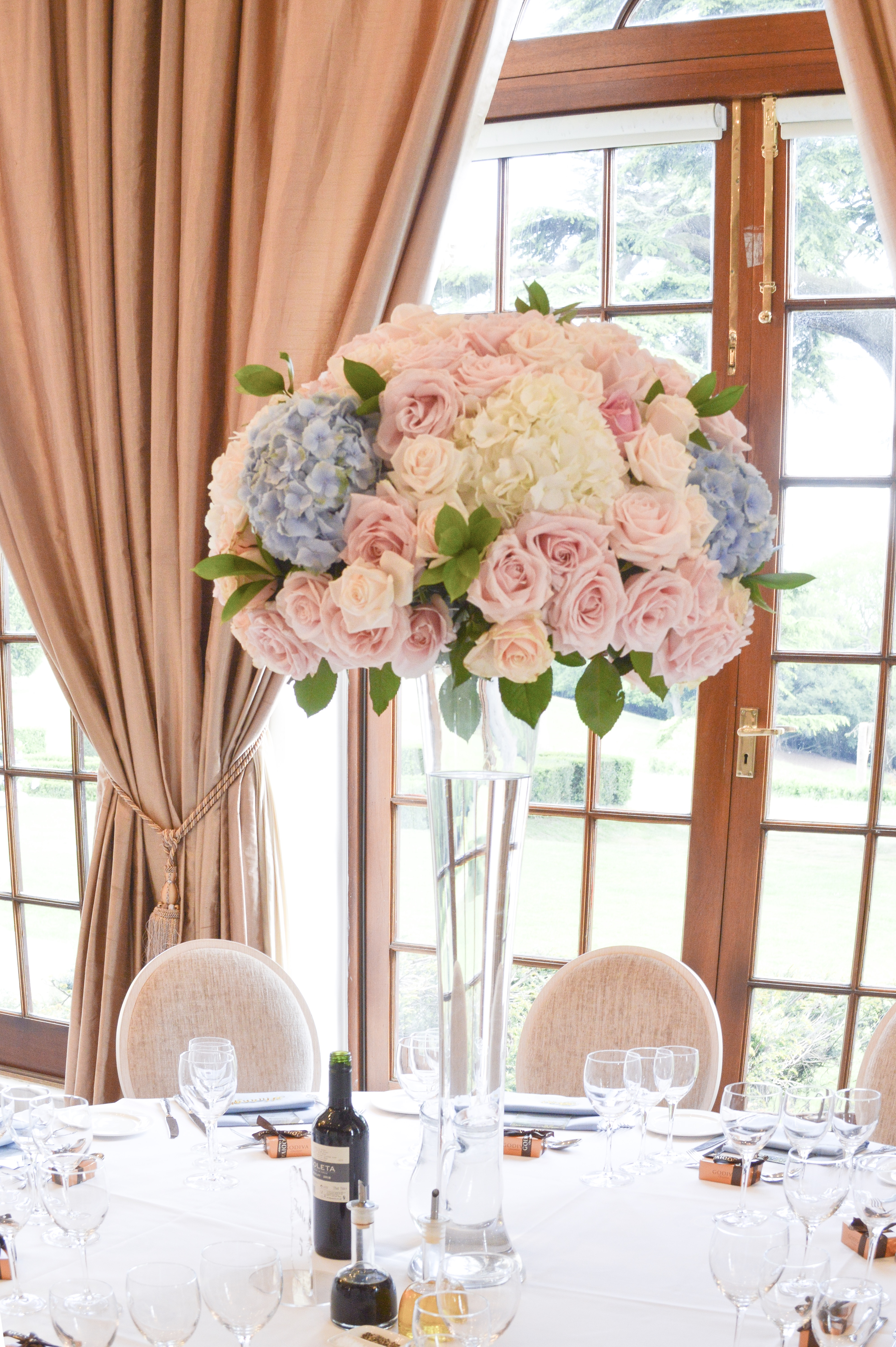 Dusty blue and pink wedding flowers reception tall centrepieces Cherie Kelly cakes London Hedsor House5