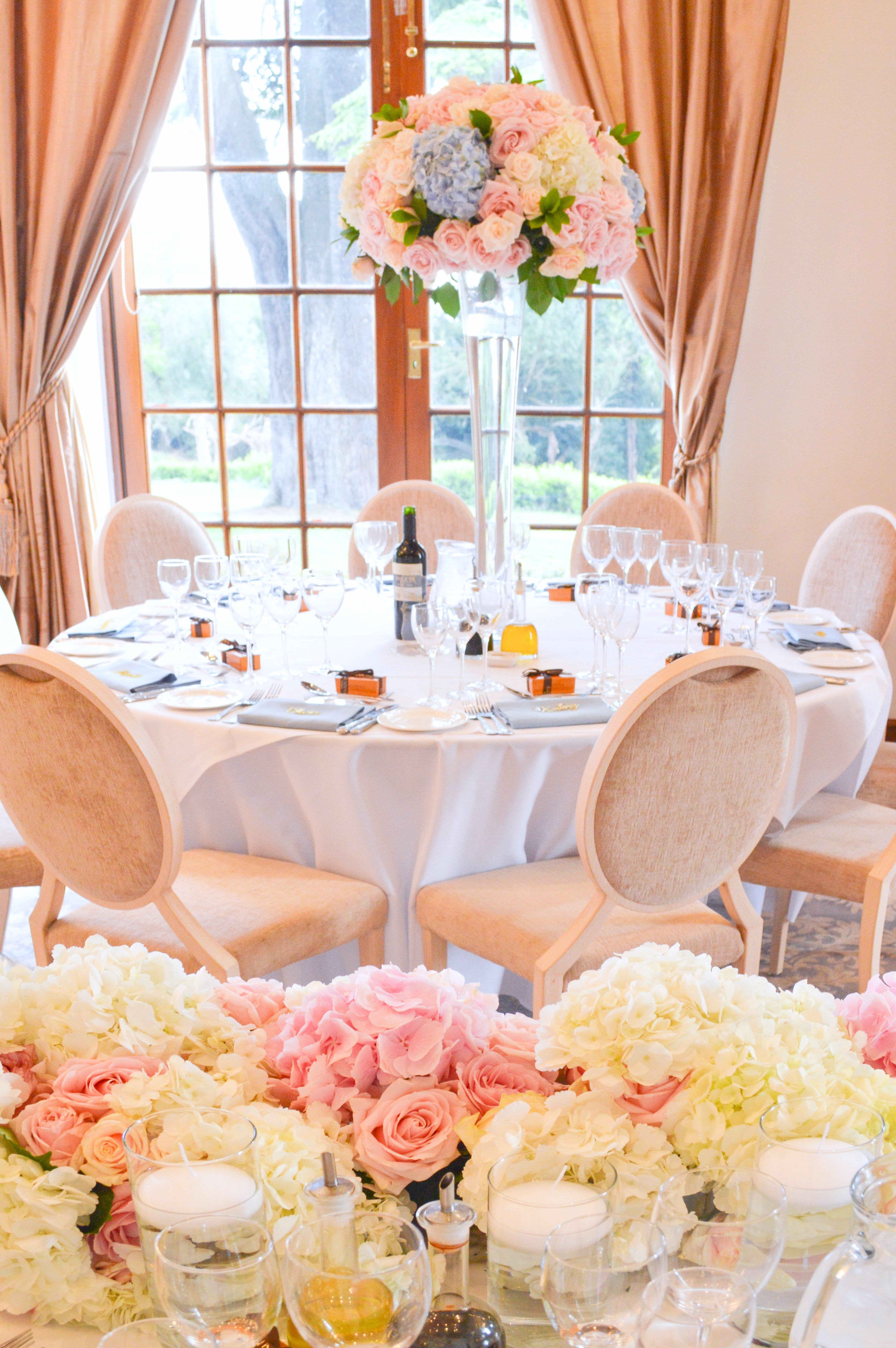 Dusty blue and pink wedding flowers reception tall centrepieces head topCherie Kelly cakes London Hedsor House 6