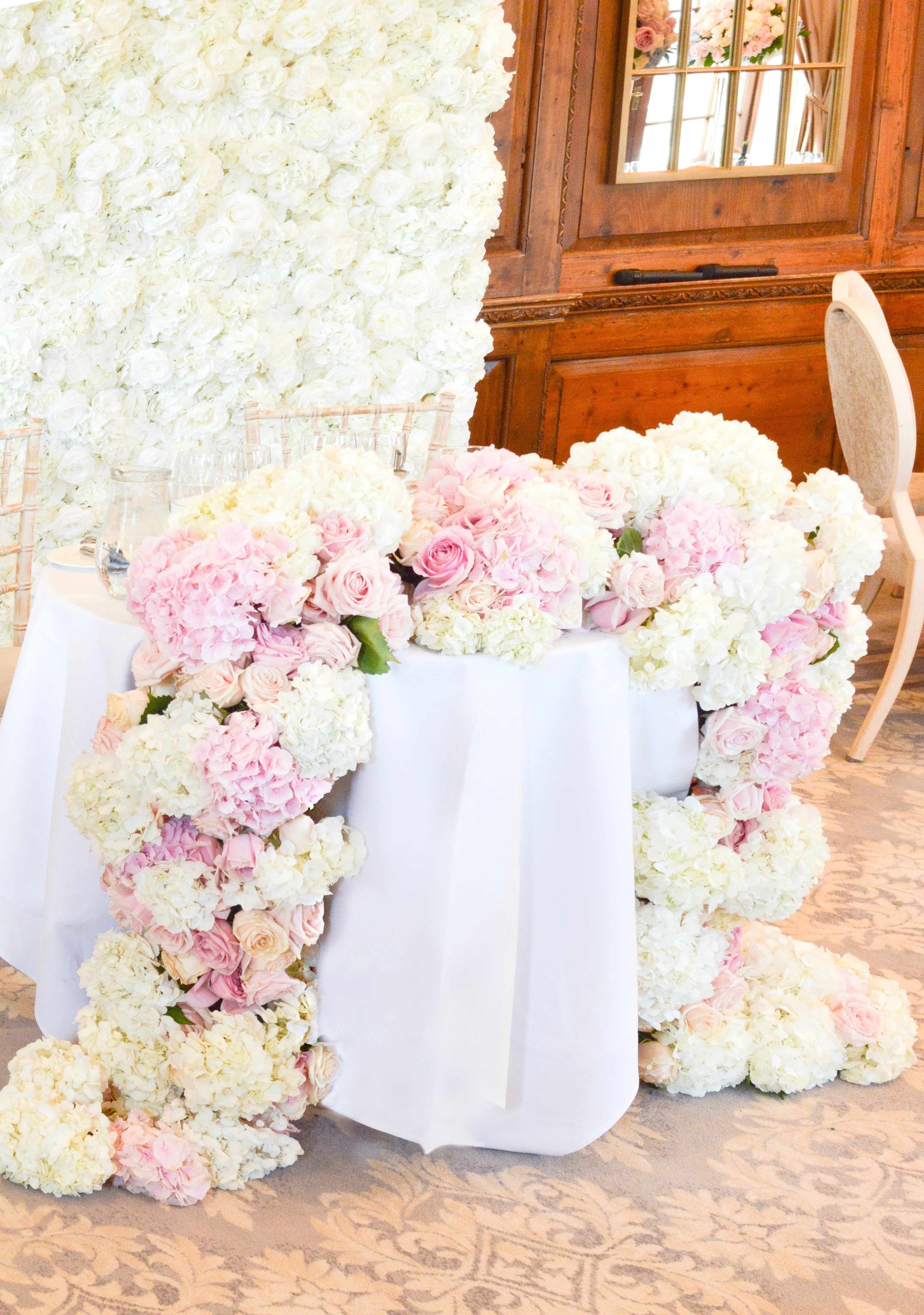 Dusty blue and pink wedding reception head toptable sweetheart table floral flower garland flower wall Cherie Kelly cakes London Hedsor House 2